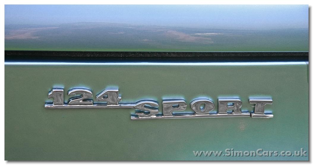 Colocar budget trasero modelo 124Sport Aa_Fiat%20124%20Spider%201969%20badger