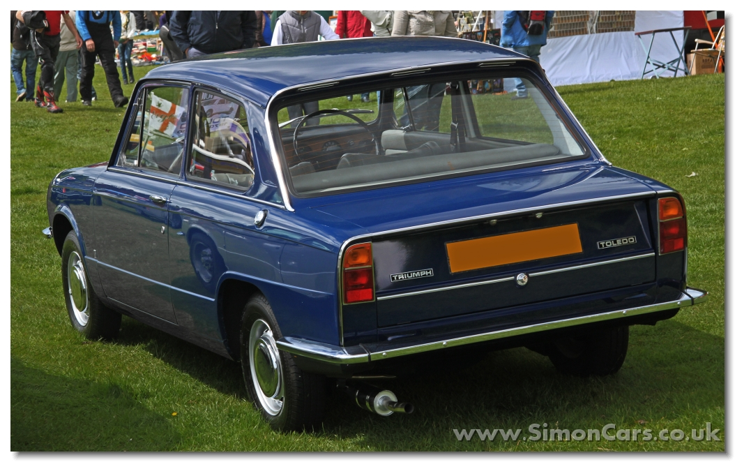 Simon cars triumph toledo for Door 2 door cars